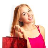 Junges erwachsenes Mädchen des Porträts mit roter Tasche Stockfoto