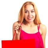 Junges erwachsenes Mädchen des Porträts mit roter Tasche Stockbilder