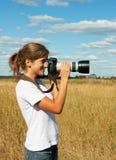 Junges Fotografmädchen stockfoto