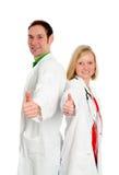Junges freundliches Ärzteteam im Laborkittel Lizenzfreies Stockfoto