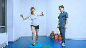Young patient training muscles after injury in rehabilitation center Stock Footage