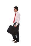 Junges Geschäftsmanngehen Stockfoto