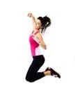 Junges glückliches sportliches Frauenspringen Lizenzfreies Stockbild
