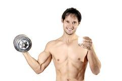Junges hübsches Musclemanlächeln Stockfotos