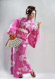 Junges japanisches Mädchen mit Fan Lizenzfreie Stockbilder