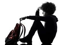 Junges Jugendlichmädchenfrauentraurigkeitskrisen-Schattenschattenbild lokalisierte stockfotografie