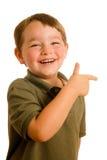 Junges Jungenkind, das eine Richtung zeigt Lizenzfreie Stockbilder