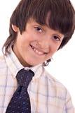 Junges Jungenlächeln Stockbild
