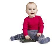 Kleinkind im weißen Hintergrund mit Festplattenlaufwerk Stockfotografie