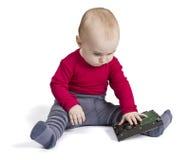 Kleinkind im weißen Hintergrund mit Festplattenlaufwerk Lizenzfreies Stockfoto