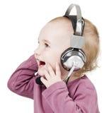Kleinkind mit Kopfhörer Stockfotos