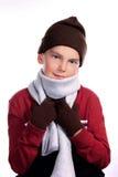 Junges Kind rollte oben in der warmen Winter-Kleidung zusammen Lizenzfreie Stockfotografie