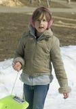 Junges Mädchen auf einem Pferdeschlitten Stockfotos