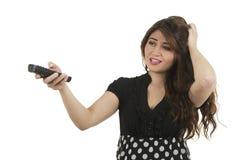 Junges Mädchen, das Fernbedienung hält Lizenzfreies Stockfoto