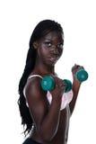 Junges Mädchen, das freie Gewichte anhebt lizenzfreie stockfotos