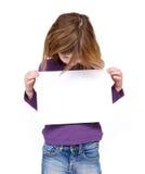 Junges Mädchen, das leeres Zeichen betrachtet Lizenzfreie Stockbilder