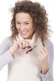 Junges Mädchen, das versucht, ihr Haar zu schneiden Lizenzfreie Stockbilder