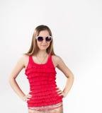 Junges Mädchen in der rosa Sommerkleidung Lizenzfreies Stockfoto