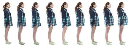 Junges Mädchen des Fotos während der Schwangerschaft im karierten Hemd Lizenzfreies Stockbild