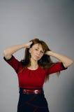 Junges Mädchen in einem roten Kleid Lizenzfreies Stockfoto