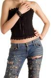 Junges Mädchen in einem schwarzen Korsett und in der Blue Jeans stockfotografie