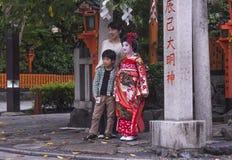 Junges Mädchen gekleidet als Geisha Lizenzfreie Stockfotografie