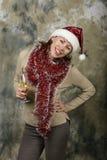 Junges Mädchen gekleidet als Weihnachtsmann Lizenzfreie Stockbilder