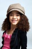 Junges Mädchen im braunen Hut Lizenzfreie Stockfotografie