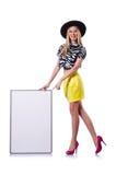 Junges Mädchen im bunten Kleid mit dem Plakat lokalisiert Lizenzfreie Stockbilder