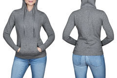 Junges Mädchen im grauen Sweatshirt, Kapuzenpullis Weißer Hintergrund Lizenzfreies Stockfoto