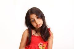 Junges Mädchen im roten Kleid Stockbild