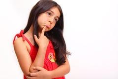 Junges Mädchen im roten Kleid Stockfoto