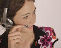 Junges Mädchen mit dem Ohr/Mundstück Stockbilder