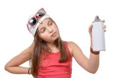 Junges Mädchen mit einer Spraydose Stockfotografie