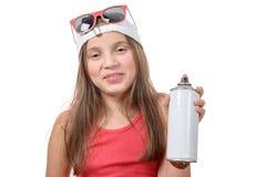 Junges Mädchen mit einer Spraydose Lizenzfreie Stockbilder