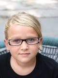 Junges Mädchen mit Gläsern Lizenzfreies Stockbild