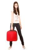 Junges Mädchen mit Koffer auf einem weißen Hintergrund Stockfotos