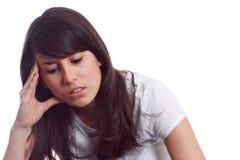 Junges Mädchen mit Kopfschmerzen stockfoto