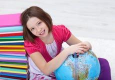 Junges Mädchen mit Studienmaterialien Lizenzfreie Stockfotos