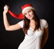 Junges Mädchen mit Weihnachts-Sankt-Hut Stockbilder