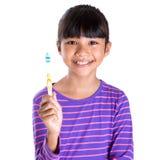 Junges Mädchen mit Zahnbürste III Stockfotografie