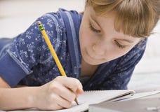 Junges Mädchen-Schreiben Lizenzfreie Stockfotografie