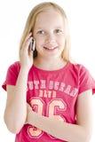 Junges Mädchen am Telefon lizenzfreies stockbild