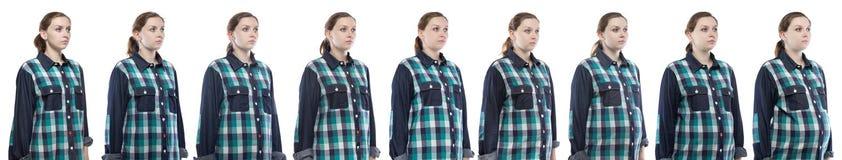 Junges Mädchen während der Schwangerschaft im karierten Hemd Stockbilder