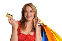 Junges Mädchen holdind Einkaufenbeutel und -Kreditkarte Stockfotos