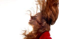 Junges Mädchen mit dem Haar in der Bewegung Lizenzfreie Stockfotografie