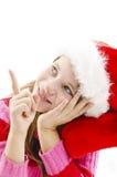 Junges Mädchen in rotem Sankt-Hut, Kopienraum oben schauend und zeigen Lizenzfreie Stockfotos