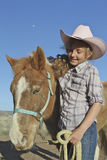Junges Mädchen und Pony Stockfotos