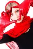 Junges süßes sorgloses Mädchen in den roten Handschuhen Stockbilder