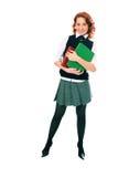 Junges schönes Kursteilnehmermädchen mit Büchern in der Hand stockbild